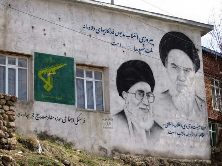 painting of religious leaders Khomenei and Khamenei on a building in Iran