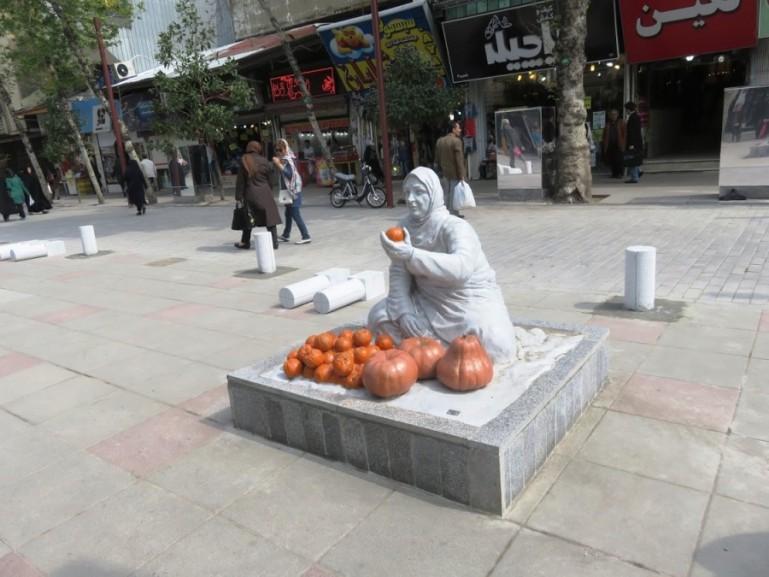 Statue of lady seeling oranges in Masuleh Iran