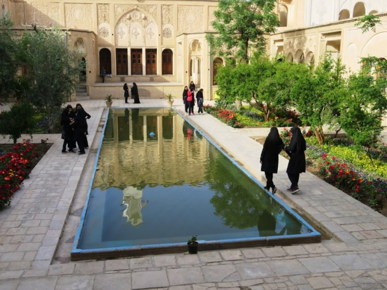 Iranian school girls in the courtyard of Borujedri house in Kashan