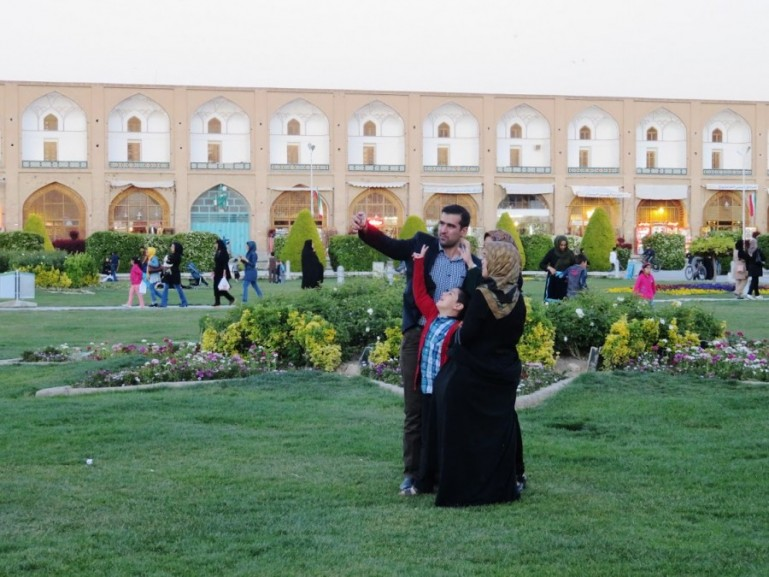 Iranians taking selfies at Naqs-e Jahan square in Isfahan. One of the top tourist attractions in Iran.