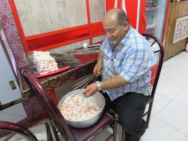 A man making kebabs from sheeps fat in Yazd