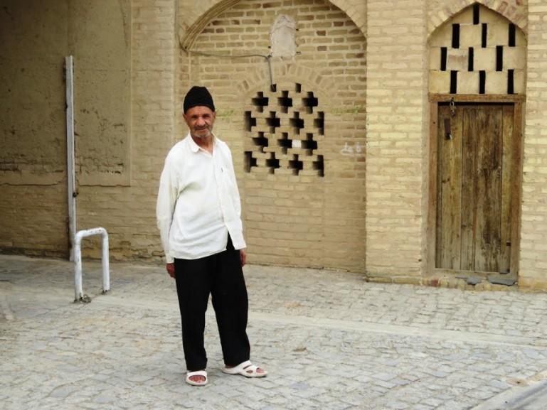 A man at the old mosque in Nain near Yazd Iran