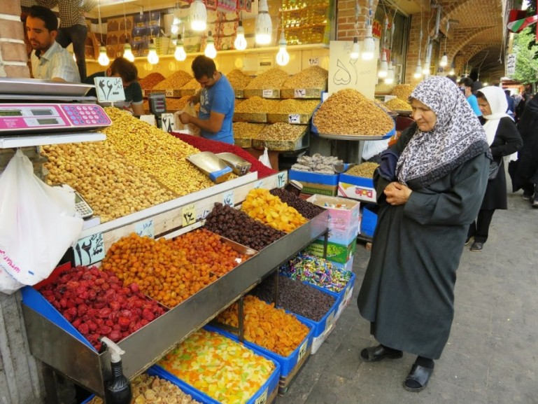 Women looking to buy dried fruits and nuts at the main entrance of the Tehran grand bazaar