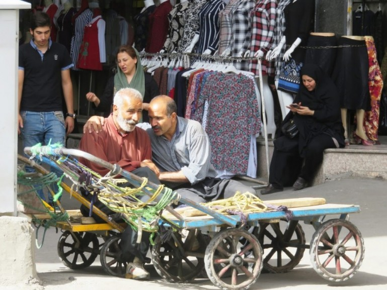 Men chatting with each other at the Tehran grand bazaar
