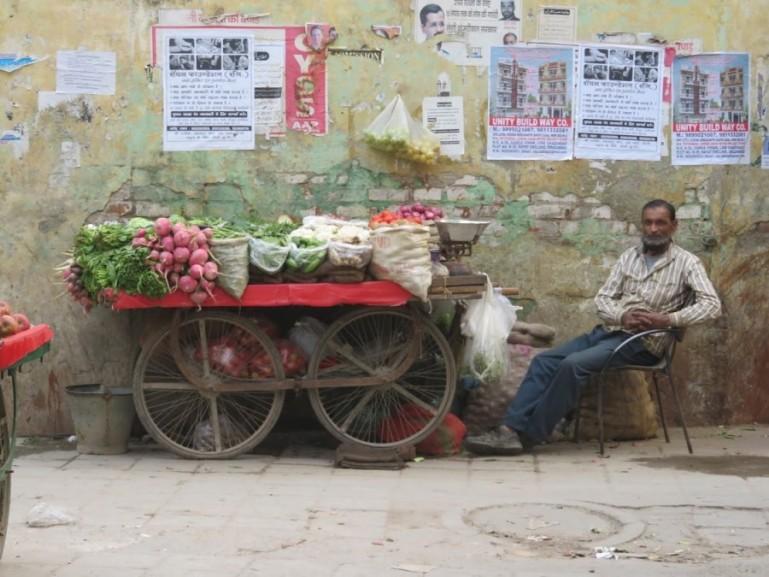 Selling fruits at Nizamuddin Basti in Delhi, India