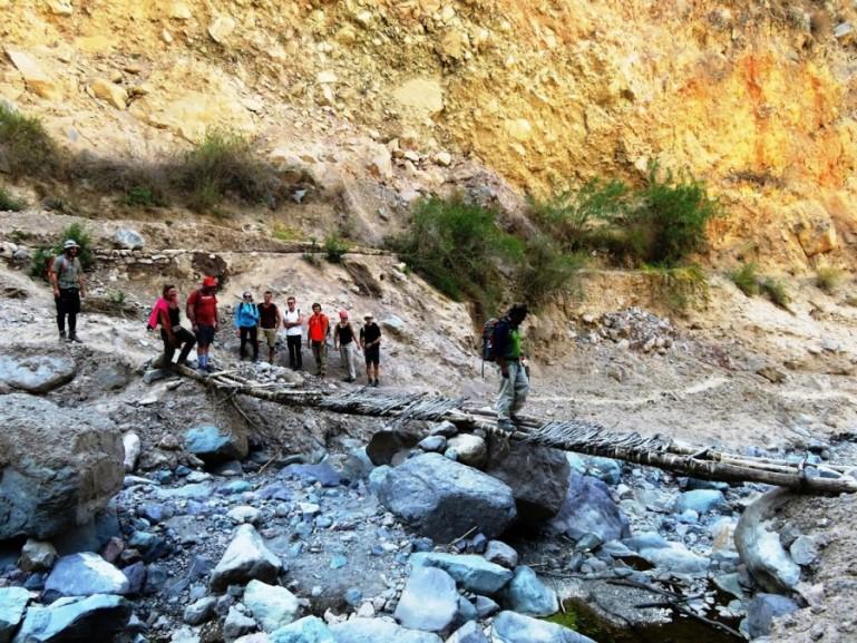 Crossing a bridge on the Colca Canyon trek