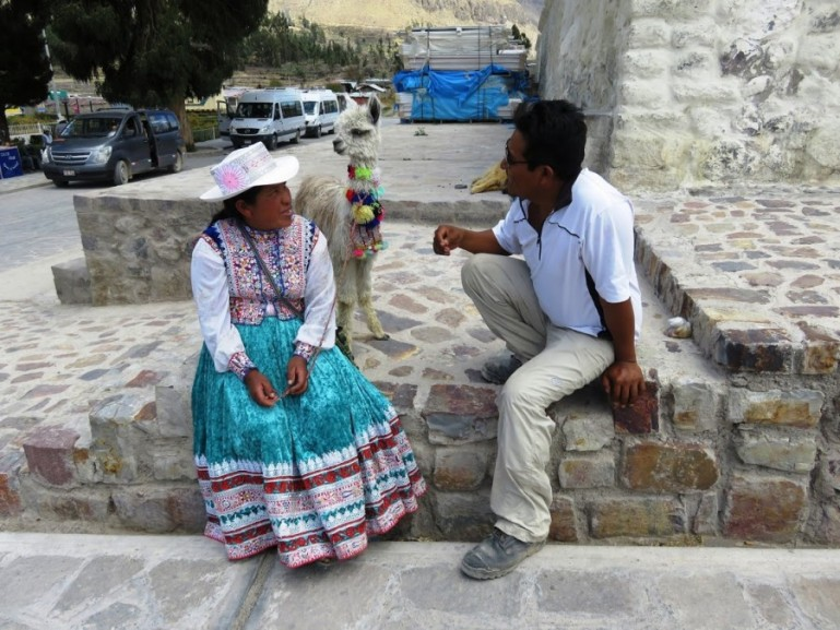 women with her lama in yanque. One of the stops on our Colca Canyon tour
