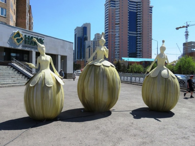 three statues of Kazakh ladies on the streets in Nursultan Astana