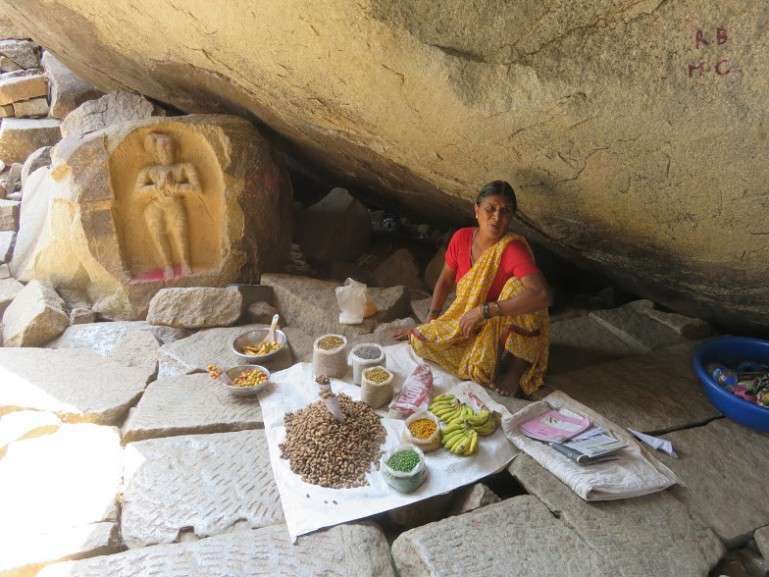 Lady selling souvenirs in Hampi near the vittala temple.One of the best places to visit in Hampi