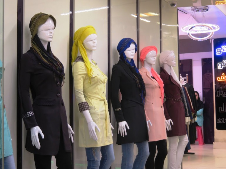 Manteaus in a fashion store in Iran. As a woman traveling to Iran it is possible to buy clothes in Iran