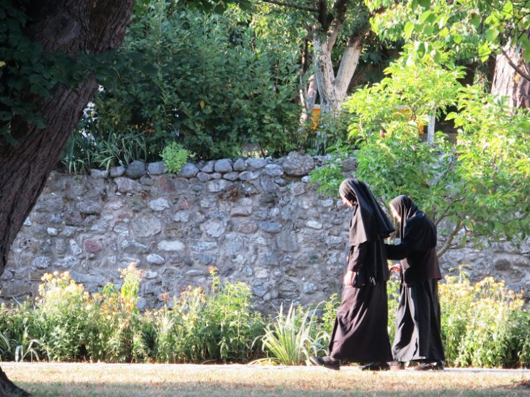 Two nuns walking in the Peja monastery in Kosovo