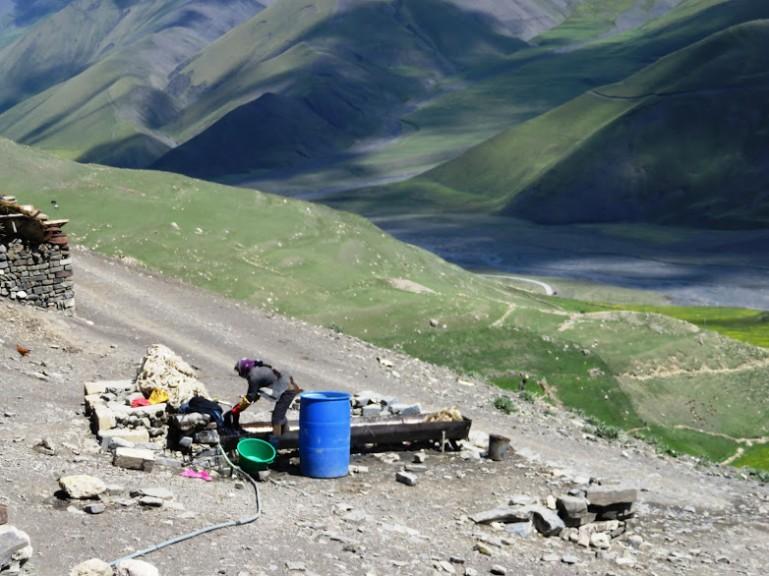 Women doing laundry in Xinaliq, Khinaliq, Khinalug
