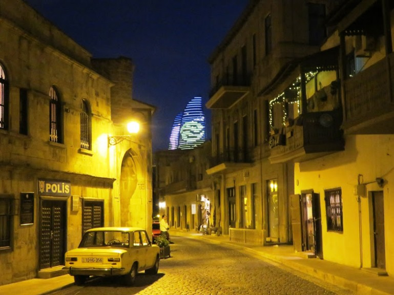 view on the flame towers from the old town in Baku by night