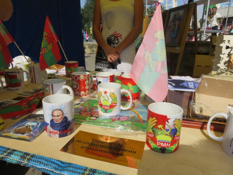 Putin and Transnistria souvenirs on a market stand during Tiraspol's independence