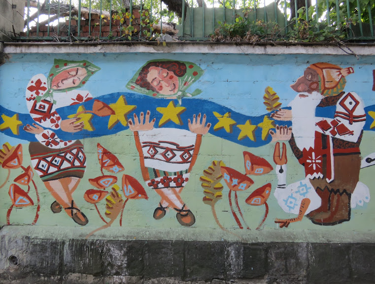 Mural paintings on the wall of the abandoned Soviet stadium in Chisinau