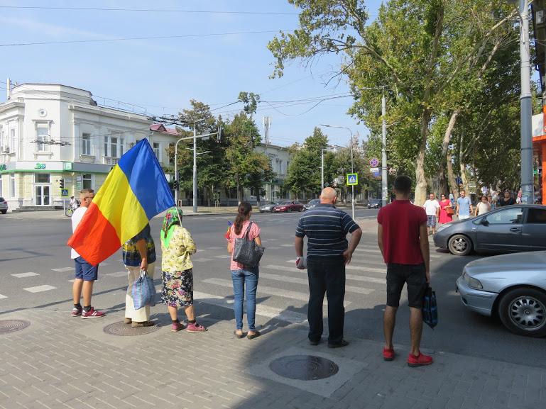 women holding Moldovan flag on Limba Noastra in Chisinau