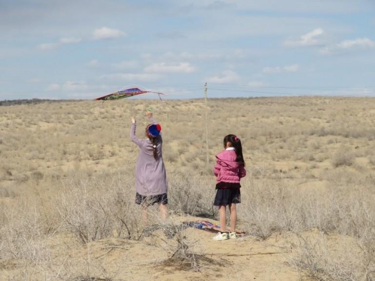 children playing kites during Nauruz in Moynaq