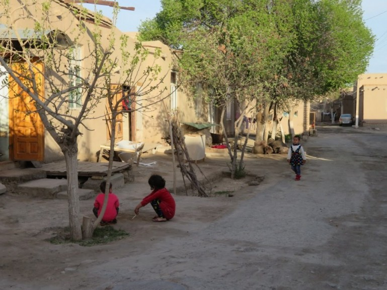 children playing in the old town of Khiva Uzbekistan