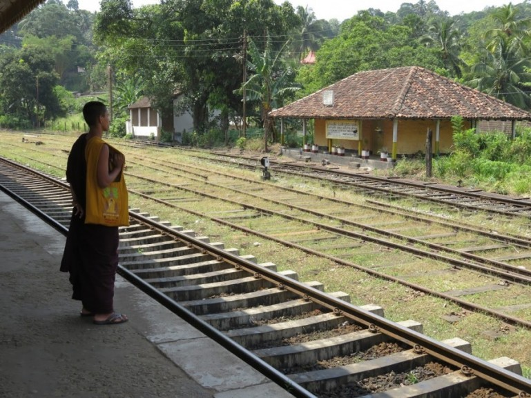 Monk waiting on the Peradeniya station for the Kandy to Ella Train