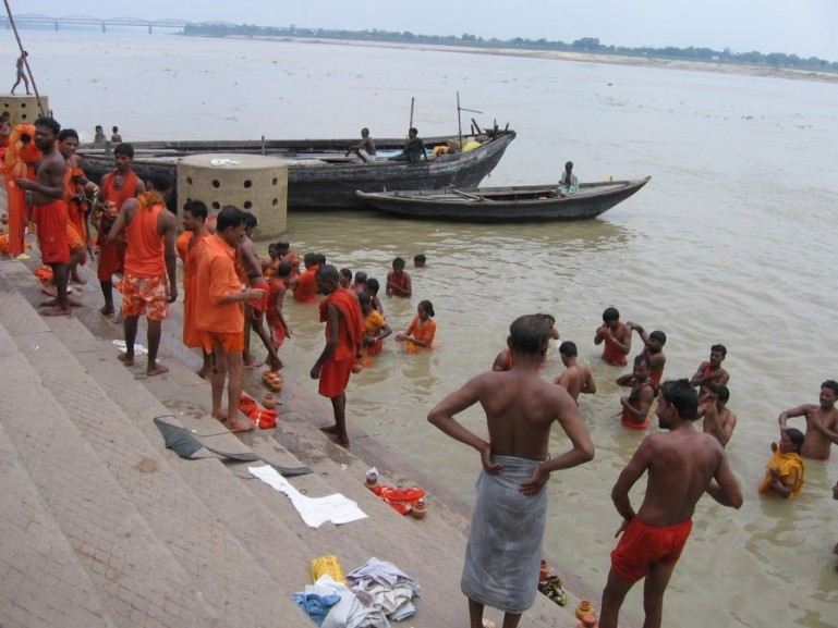 Shiva devotees bathing in the holy Ganges during Shravan Maah festival in Varanasi