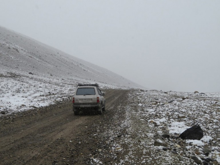 My jeep on a mountain pass during my Pamir highway tour in Tajikistan