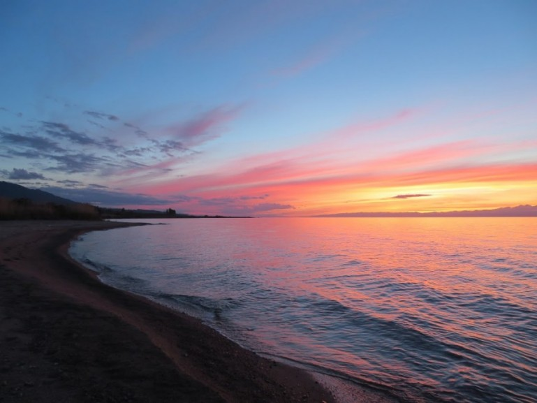 Sunset in Tosor beach at lake Issyk kul in Kyrgyzstan