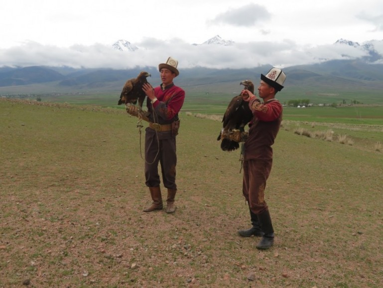 Eagle hunters at the shores of lake Issyk kul in Kyrgyzstan