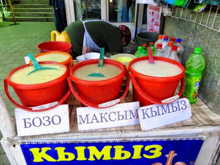 Kymyz, Maksim and Bozo are some of the national drinks in Kyrgyz food sold in buckets at Osh bazaar in Bishkek
