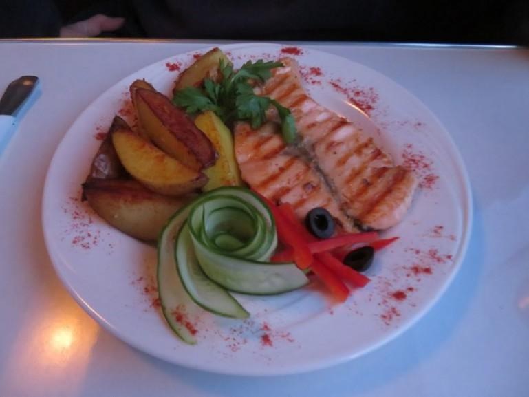 Salmon steak dinner on the Arktika train