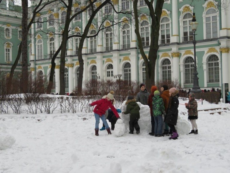 Kids playing in the gardens of the Winter palace in St Petersburg in winter