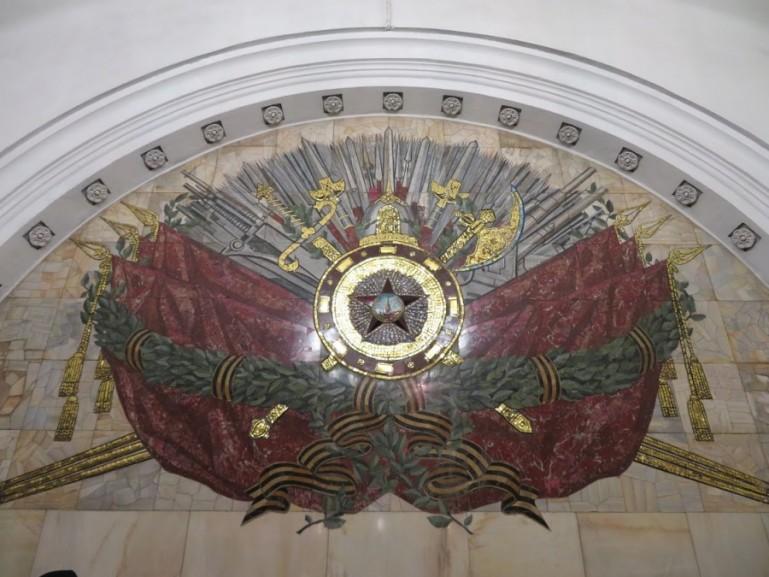 Soviet emblem at the wall of Kurskaya metro station