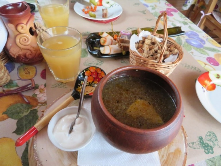 Delicious russian meal with mushroom soup and zakuski