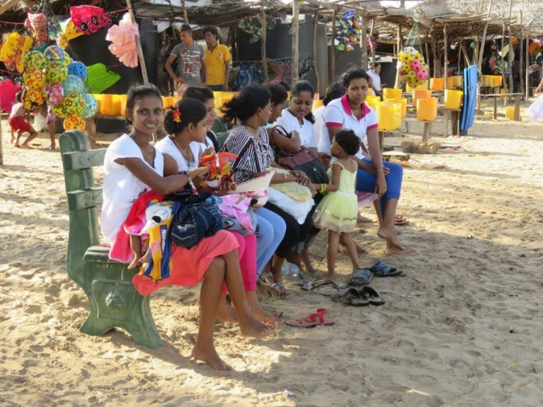 women at Kirinda beach