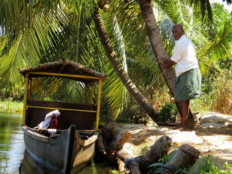 canoe on the backwaters in kerala