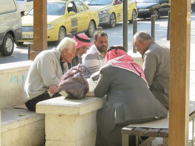 Men playing Mankala at the Al Ain plaza in Salt Jordan